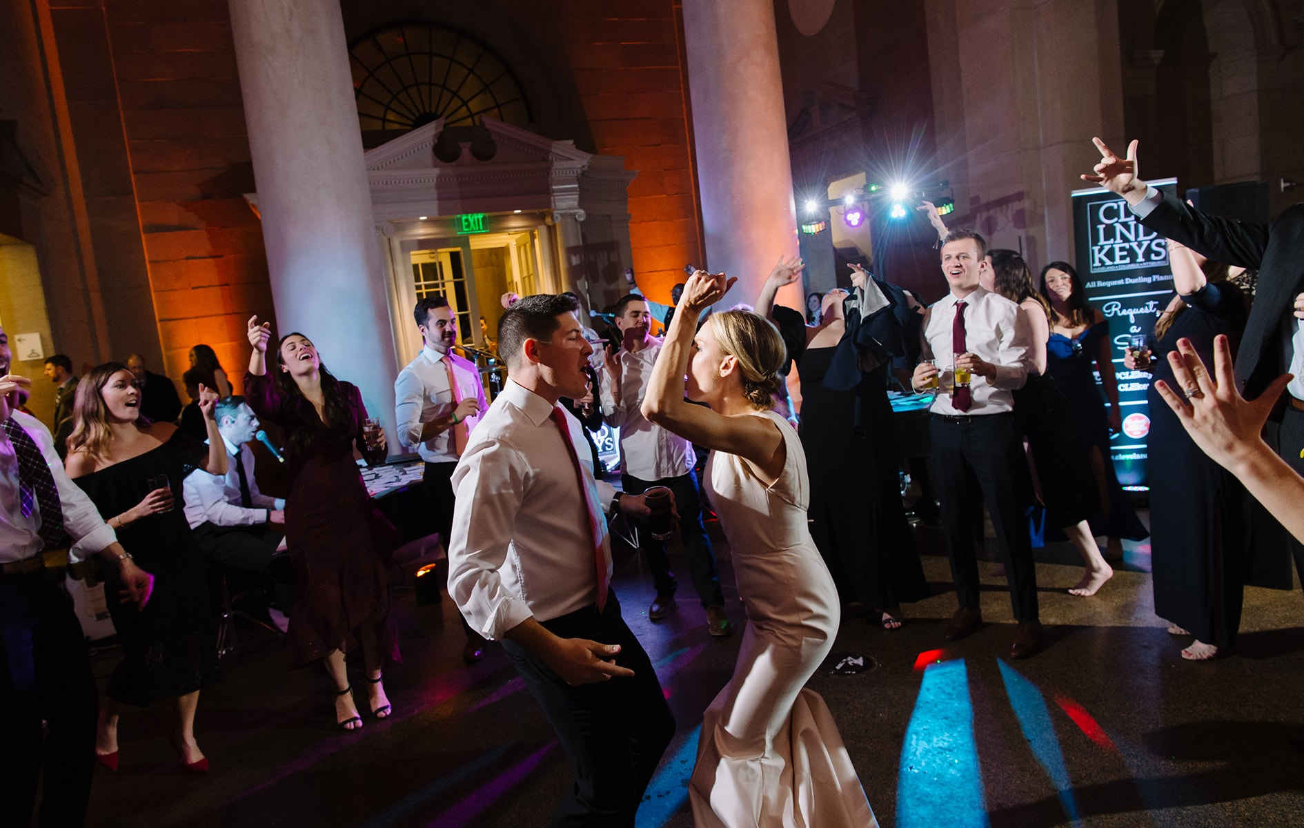 bride and groom dancing in the middle of crowd