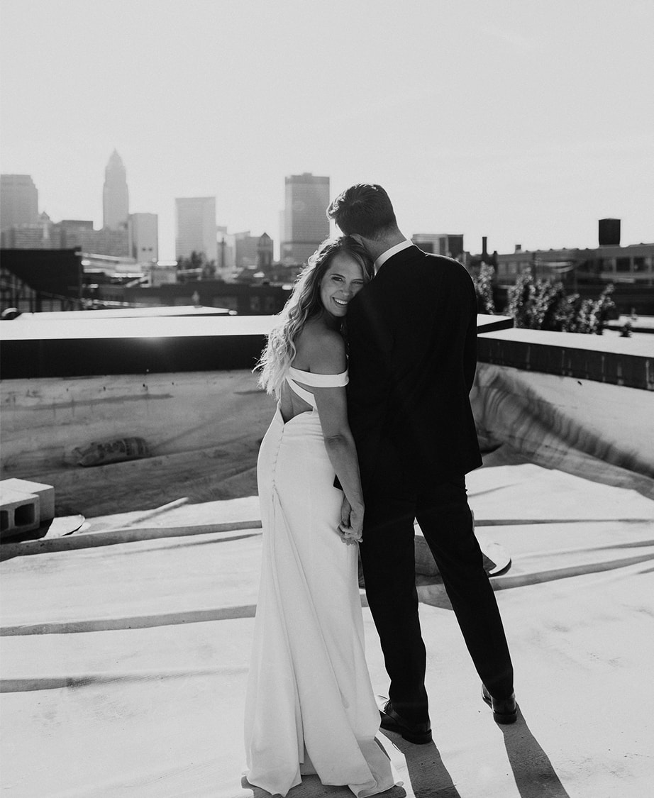 bride and groom taking portrait on rooftop