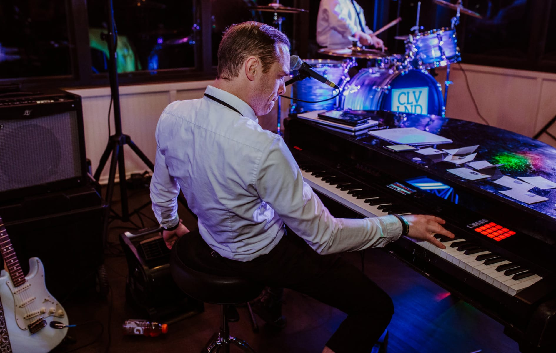 close-up of Gregg Coffey playing the piano