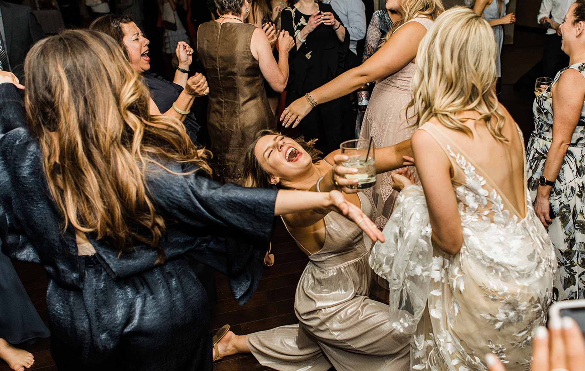 bride and her friend dancing on the dance floor